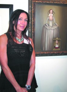 Elizabeth Cheche with her surreal work at Tieken Gallery