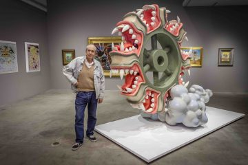 Robert Williams posing with one of his large scale sculptures